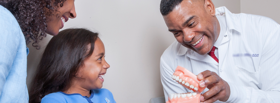 Waterloo Dentist - Erbsville Dental - A pediatric dentist with his patient